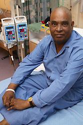 Diabetic patient relaxing on top of ward bed,