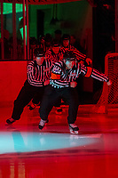 KELOWNA, BC - FEBRUARY 7: Referee Stephen Campbell leads linesmen Cody Wanner and Dustin Minty and several BC minor hockey officials onto the ice at the Kelowna Rockets against the Portland Winterhawks at Prospera Place on February 7, 2020 in Kelowna, Canada. (Photo by Marissa Baecker/Shoot the Breeze)