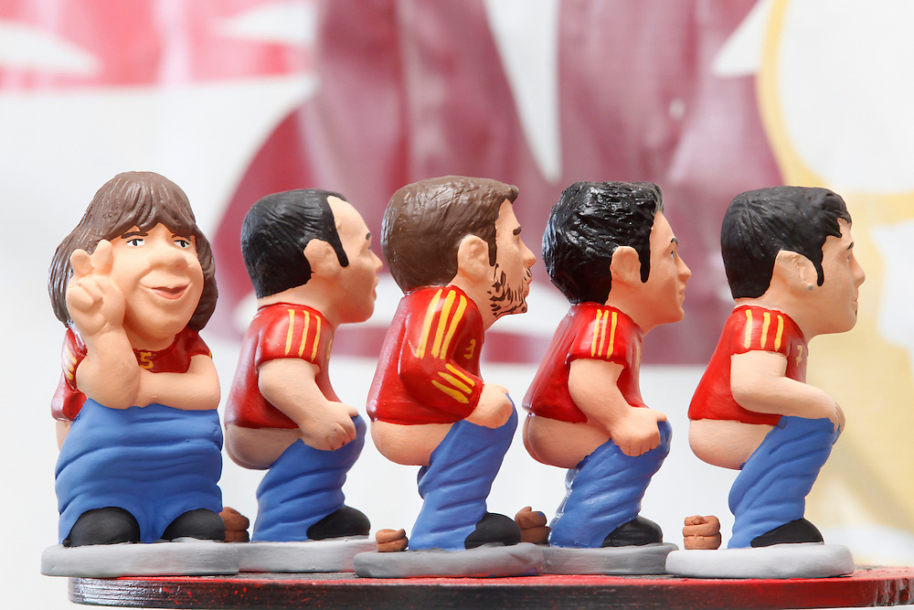 "November 10,  2010. A company in Torroella de Montgrí (Girona, Spain) called ""Caganer.com"", which specializes in the production of ""caganers"", unveiled today its new figurine for Christmas, Michael Jackson, Josn Lennon or prince Charles. .A ""Caganer"" is a small figure from Catalonia, usually made of fired clay, which depicts as squatting person in the act defecating..""Caganer"" is Catalan for pooper. It forms part of one of the typical figures of the manger or ""Nativity"" scene together with Mary, Joseph and the baby Jesus but hidden in a corner. It is a humorous figure, originally portraying a peasant wearing a ""barretina"" (a red stocking hat), and seems to date from the 18th century when it was believed that the figure's deposits would fertilize the earth to bring a prosperous year. With the course of time, the original personage of this pooping figure was substituted with personalities from the political and sports worlds and other famous personalities..The spanish football national team won the FIFA Worldcup 2010 in South Africa. From left to right Carles Puyol, Andres Iniesta, Gerard Pique, Xavi Hernandez and David Villa."