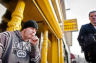 'Coffeeshops in Amsterdam' IHT story by David Jolly..Customer Andrew Chandler, 28 from the UK smoking cannabbis in front of coffeeshop Mellow Yellow in Amsterdam, the Netherlands on March 16, 2012. Mellow Yellow is oldest and first coffeeshop ever in the Netherlands