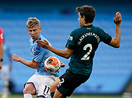 Oleksandr Zinchenko of Manchester City challenges Matthew Lowton of Burnley during the Premier League match at the Etihad Stadium, Manchester. Picture date: 22nd February 2020. Picture credit should read: Andrew Yates/Sportimage