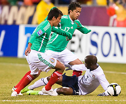 United States midfielder DaMarcus Beasley (7) battles with Mexico midfielder Pavel Pardo (8) and Mexico forward Giovani dos Santos (17).  The United States men's soccer team defeated the Mexican national team 2-0 in CONCACAF final group qualifying for the 2010 World Cup at Columbus Crew Stadium in Columbus, Ohio on February 11, 2009.