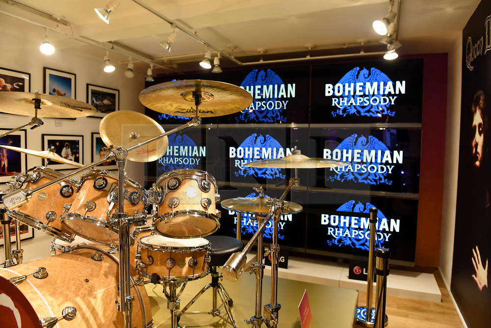 """© Licensed to London News Pictures. 18/10/2018. LONDON, UK. Roger Taylor's drum kit on display in the Queen pop-up shop which has opened in Carnaby Street.  Coinciding with the release next week of the movie """"Bohemian Rhapsody"""", the shop offers Queen music fans memorabilia, a display of stage costumes as well as archived Queen performance footage.  Photo credit: Stephen Chung/LNP"""