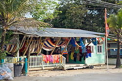 Roatan, Honduras:  A boutique on the main drag of West Bay, the commercial settlement at the far end of this barrier island off the north coast of Honduras.  Very typical street scene.