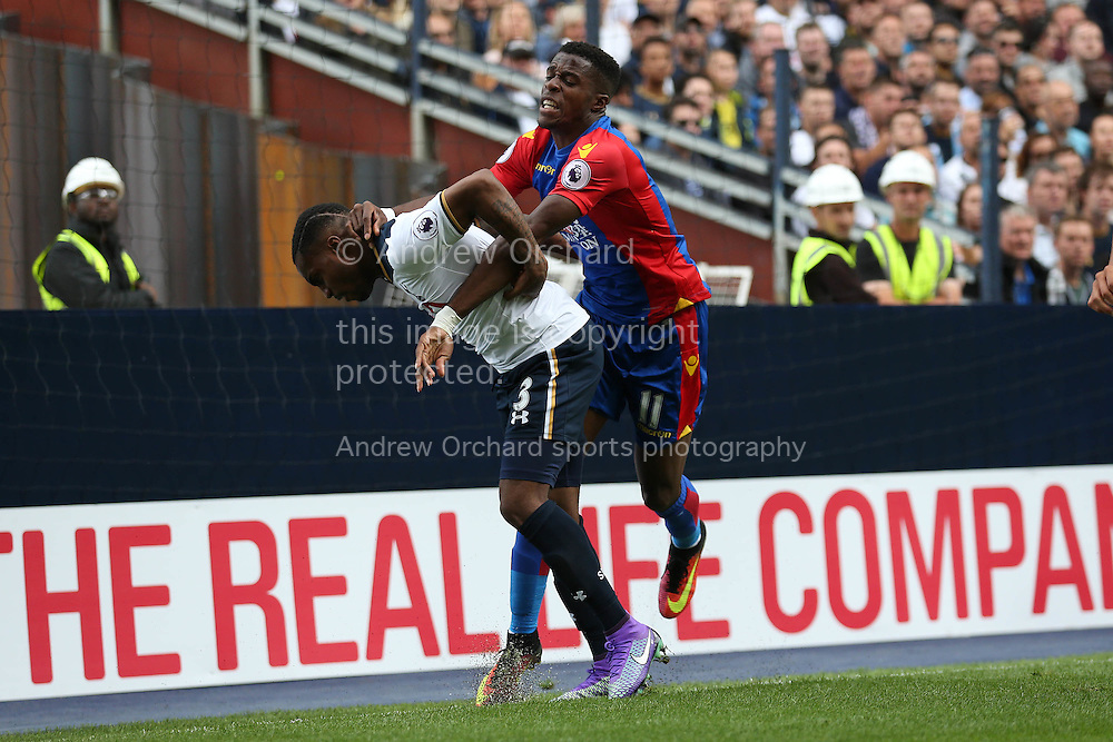 Wilfried Zaha of Crystal Palace clashes with Danny Rose of Tottenham Hotspur. Premier league match, Tottenham Hotspur v Crystal Palace at White Hart Lane in London on Saturday 20th August 2016.<br /> pic by John Patrick Fletcher, Andrew Orchard sports photography.