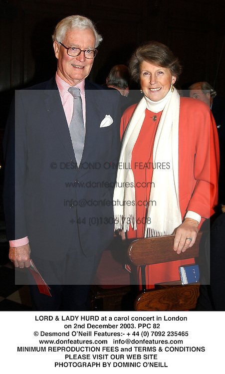 LORD & LADY HURD at a carol concert in London on 2nd December 2003.<br /> PPC 82