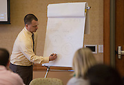 Andy Foder, a finance professor, leads a breakout session during the College of Business Center for Leadership Event on April 23, 2016 in Baker Center.