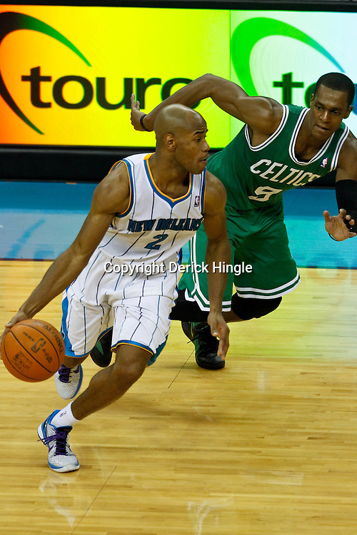 December 28, 2011; New Orleans, LA, USA; New Orleans Hornets point guard Jarrett Jack (2) drives past Boston Celtics point guard Rajon Rondo (9) during the fourth quarter of a game at the New Orleans Arena. The Hornets defeated the Celtics 97-78.  Mandatory Credit: Derick E. Hingle-US PRESSWIRE