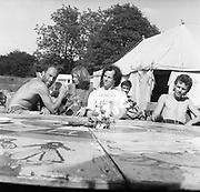 Bill Stewart and a group of people sitting by a round table, Glastonbury, Somerset, 1989