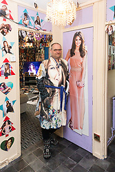 Shaun Smith, 52, from Basildon in Essex poses next to his idol in a Cheryl Cole dressing gown he had made especially for himself. He has, at a cost of around £7,000 built up a huge collection of Cheryl Cole memorabilia in the space of about eight months after she impressed him in a music video he was watching.. PLACE, January 24 2019.