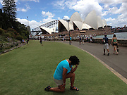 """After planking comes Tebowing, Craze inspired by US Football star Tim Tebow sweeps globe<br /> <br /> BRITAIN is on its knees — copying the latest trendy pose sweeping the globe.<br /> Fans of Tebowing have been bending on one knee and putting a hand to their head at sites including Buckingham Palace, Parliament, Abbey Road, Windsor Castle and Stonehenge.<br /> It is named after the praying stance of Denver Broncos American Football star Tim Tebow and follows other """"must-do"""" poses such as planking.<br /> The term """"To Tebow"""" has even entered the Urban Dictionary as: """"To get down on a knee and start praying, even if everyone else around you is doing something completely different.""""<br /> To take a good Tebowing photo, people are advised to kneel on the knee closest to the camera and place their elbow on their other knee.<br /> <br /> They should then place their forehead against their hand on that arm, drop their other arm and pray.<br /> The pose has been likened to that of Rodin's famous sculpture The Thinker.<br /> Quarterback Tebow, 24, is the son of Christian missionaries and he has previously written the names of Biblical verses on his face ahead of games.<br /> He now kneels in prayer on the sidelines before and after NFL matches.<br /> The new craze has seen his name rocket to the top of Google's trending searches and Tebow tweeted """"Love it!"""" as his trademark move went global.<br /> ©tebowing.com/Exclusivepix"""
