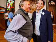 27 APRIL 2019 - STUART, IOWA: ANDREW YANG, candidate for the Democratic nomination for the US presidency, right, talks to a person at the Reaching Rural Voters Forum in Stuart. The forum was an outreach by Democrats in Iowa's 3rd Congressional District to mobilize Democratic voters statewide. Iowa saw one of the largest shifts from Democrats to Republicans in the 2016 Presidential election and Trump won the state by double digits. Republicans control the governor's office and both chambers of the Iowa legislature. Iowa traditionally hosts the the first selection event of the presidential election cycle. The Iowa Caucuses will be on Feb. 3, 2020.                                PHOTO BY JACK KURTZ