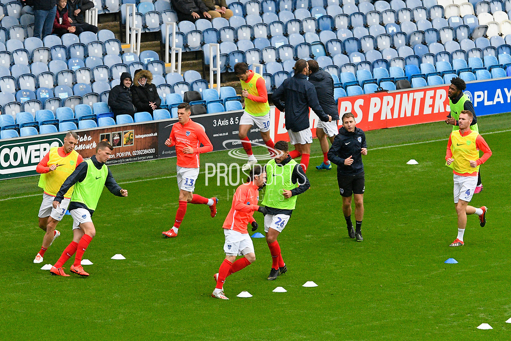 Portsmouth players warming up ahead of the EFL Sky Bet League 1 match between Portsmouth and Gillingham at Fratton Park, Portsmouth, England on 12 October 2019.