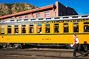 Passenger car and docent on the Durango & Silverton Narrow Gauge Railroad, Durango, Colorado USA