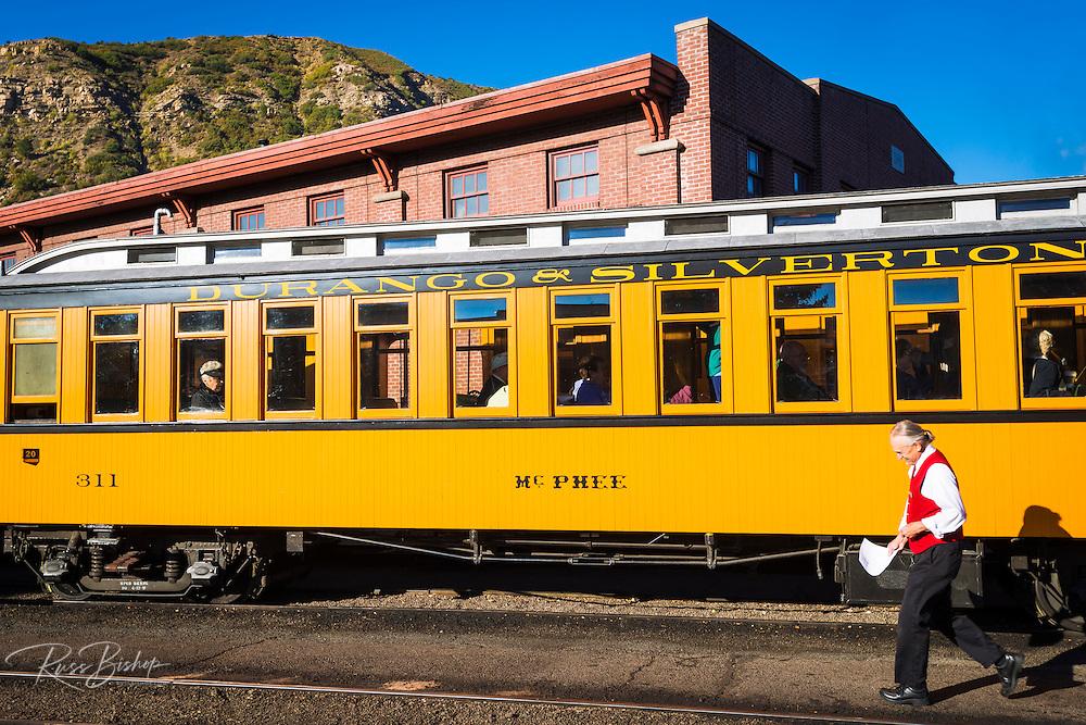 Passenger car and docent on the Durango & Silverton Narrow Gauge Railroad, Durango, Colorado USA