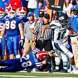 December 4, 2010; Ruston, LA, USA;  Nevada Wolf Pack quarterback Colin Kaepernick (10) runs past \Louisiana Tech Bulldogs cornerback Terry Carter (28) during the first half at Joe Aillet Stadium.  Mandatory Credit: Derick E. Hingle