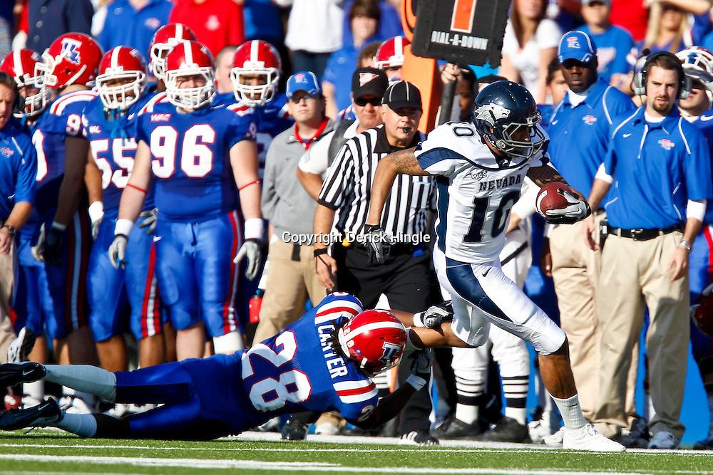 December 4, 2010; Ruston, LA, USA;  Nevada Wolf Pack quarterback Colin Kaepernick (10) runs past \Louisiana Tech Bulldogs cornerback Terry Carter (28) during the first half at Joe Aillet Stadium.  Mandatory Credit: Derick E. Hingle