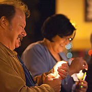 David Post holds a candle during a candlelight vigil in memory of Zoe Post in Troy, Ala., Monday, Dec. 15, 2014. Family, friends and community members gathered to honor the memory of Post on her birthday. Post died two years ago. David Post, Zoe's father, said they were 'remembering her life' and raising awareness of the effects of bullying. (Photo/Thomas Graning)