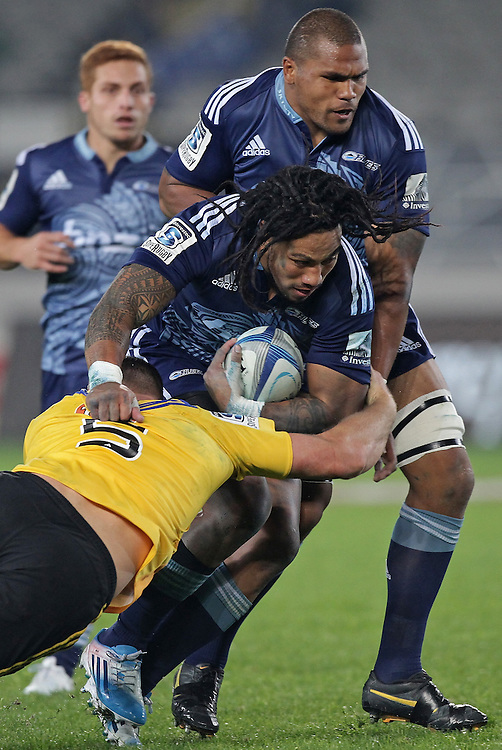 Hurricanes' James Broadhurst tackles Blues' Ma'a Nonu in a Super Rugby match, Eden Park, Auckland, New Zealand, Saturday, May 31, 2014.  Credit:SNPA / David Rowland