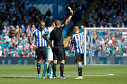Referee John Brooks issues a yellow card to Barry Bannan of Sheffield Wednesday during the EFL Sky Bet Championship match between Sheffield Wednesday and Queens Park Rangers at Hillsborough, Sheffield, England on 31 August 2019.