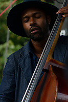 """The 12th annual Hyde Park Jazz Festival was held this weekend, Saturday, September 29th and Sunday, September 30th, 2018 at various venues around Hyde Park. Jazz musicians from all around came out to play at the two-day event. <br /> <br /> Basist, Junius Paul performed Sunday afternoon on the Midway Plaisance located at 1130 Midway Plaisance on the University of Chicago campus.<br /> <br /> Please 'Like' """"Spencer Bibbs Photography"""" on Facebook.<br /> <br /> Please leave a review for Spencer Bibbs Photography on Yelp.<br /> <br /> Please check me out on Twitter under Spencer Bibbs Photography.<br /> <br /> All rights to this photo are owned by Spencer Bibbs of Spencer Bibbs Photography and may only be used in any way shape or form, whole or in part with written permission by the owner of the photo, Spencer Bibbs.<br /> <br /> For all of your photography needs, please contact Spencer Bibbs at 773-895-4744. I can also be reached in the following ways:<br /> <br /> Website – www.spbdigitalconcepts.photoshelter.com<br /> <br /> Text - Text """"Spencer Bibbs"""" to 72727<br /> <br /> Email – spencerbibbsphotography@yahoo.com<br /> <br /> #SpencerBibbsPhotography #HydePark #Community #Neighborhood<br /> #Music<br /> #HydeParkJazzFestival<br /> #Jazz<br /> #LiveMusic<br /> #JuniusPaul"""