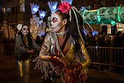 New York, NY - October 31, 2015. A dancing Calavera Catarina warming up before the start of the Greenwich Village Halloween Parade.