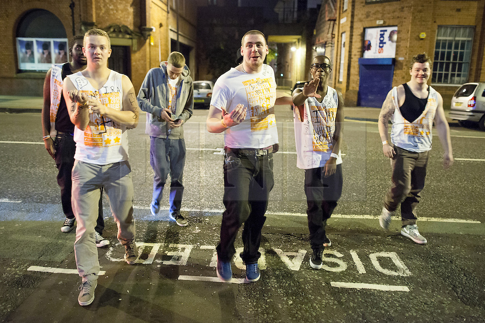 """© Licensed to London News Pictures . 21/10/2012 . Manchester , UK . 2nd from left: a student with """" BNP """" , """" IRA """" and a Swastika drawn on his Carnage UK t-shirt and """" Squeeze 4 a squirt """" written on his arm . Students attend a Carnage UK pub crawl at bars in Manchester 's Deansgate Locks with a fancy dress theme of """" Pimps and Hoes """" . The event has been criticised for encouraging binge drinking , sexism and anti-social behaviour . Photo credit : Joel Goodman/LNP"""