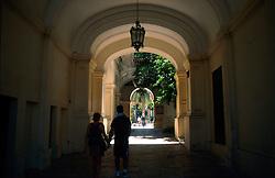 MALTA VALETTA JUL00 - Pedestrians in an alleyway leading to secluded gardens in Old Valetta.....jre/Photo by Jiri Rezac....© Jiri Rezac 2000....Tel:   +44 (0) 7050 110 417..Email: info@jirirezac.com..Web:   www.jirirezac.com