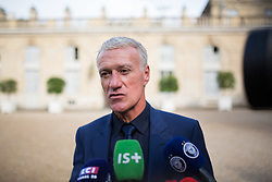 France's national trainer Didier Deschamps speak to the press leaves after receiving the Legion of Honour during a ceremony to award French 2018 football World Cup winners, on June 4, 2019, at the Elysee Palace in Paris. Photo by Raphael Lafargue/ABACAPRESS.COM
