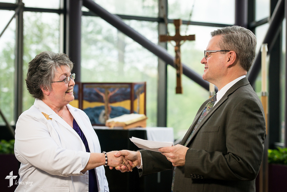 Sally Handrick, chairman of the Mission Grants Committee for the Lutheran Women's Missionary League, presents the Rev. Kevin Robson, LCMS chief mission officer, with a check for a grant awarded to LCMS Disaster Response on Thursday, April 21, 2016, in the International Center chapel of The Lutheran Church–Missouri Synod in Kirkwood, Mo.  The grant will be used to help more than 20 LCMS congregations purchase and outfit disaster-response trailers for use in their respective districts. LCMS Communications/Erik M. Lunsford