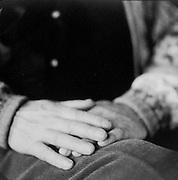 Folded hands of an older man