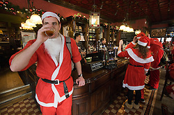 © under license to London News Pictures.  12/12/2010 The Black Lion pub meeting point, West London. Londoners dressed in Santa Claus costumes participate in 'SantaCon', a Santa-themed pub crawl across London yesterday (11/12/2010). Similar SantaCon events take place in various cities around the world, with an emphasis on having fun and spreading seasonal good cheer to passers by. Photo credit should read: London News Pictures