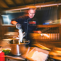 Chef Jim Shirah of Northern Florida prepares a plate of lionfish. Red lionfish (Pterois volitans) are considered the worst invasive species case in human history. Native to the Indian and Pacific oceans they were first spotted in the Atlantic in the 1980's. By the early 2000's they had spread like a virus through the tropcial Caribbean wreaking havoc on native fish species and ecosystems.Image made off Destin, Florida.Their white, flaky meat is often compared to grouper and snapper and is considered especially delicious. According to Jim, lionfish is one of their most popular dishes because they taste great and are guilt-free.
