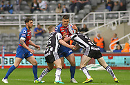 Jordan Johnson and Ed Chamberlain(R) of Widnes Vikings tackle Joe Arundel (C) of Wakefield Trinity during the Betfred Super League match at the Dacia Magic Weekend at St. James's Park, Newcastle<br /> Picture by Stephen Gaunt/Focus Images Ltd +447904 833202<br /> 20/05/2017