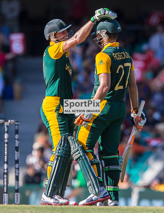 ICC Cricket World Cup 2015 Tournament Match, South Africa v West Indies, Sydney Cricket Ground; 27th February 2015<br /> South Africa&rsquo;s AB De Villiers pats South Africa&rsquo;s Rilee Rossouw after South Africa&rsquo;s Rilee Rossouw scored his 50