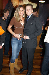 MISS CHARLOTTE HARVEY and HARRY LAWSON-JOHNSTON at the opening party of Pengelley's, 164 Sloane Street, London SW1 on 22nd February 2005.<br />