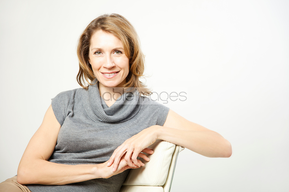 Portrait of a woman sitting on chair