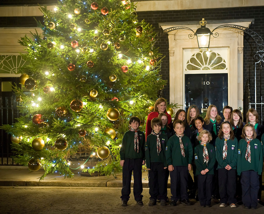 LONDON - DECEMBER 08: Sarah Brown, the wife of Prime Minister Gordon Brown switches on the lights of the Christmas tree outside Number 10 Downing St on December 8, 2008 in London, England. Mrs Brown is assisted in the annual official switch-on by members of the Scouts and Guides....Please telephone : +44 (0)845 0506211 for usage fees .***Licence Fee's Apply To All Image Use***.IMMEDIATE CONFIRMATION OF USAGE REQUIRED.*Unbylined uses will incur an additional discretionary fee!*.XianPix Pictures  Agency  tel +44 (0) 845 050 6211 e-mail sales@xianpix.com www.xianpix.com