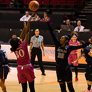 10 February 2018: The San Diego State Aztecs women's basketball team hosts Nevada on Play4Kay day at Viejas Arena. San Diego State Aztecs guard Cheyenne Greenhouse (30) attempts a jump shot over Nevada Wolf Pack forward AJ Cephas (32) in the first half. <br /> More game action at www.sdsuaztecphotos.com