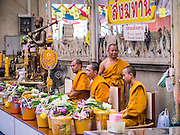 12 OCTOBER 2012 - RAI KHRING, NAKHON PATHOM, THAILAND:  Buddhist monks lead a chanting session Wat Rai Khring in Nakhon Pathom province. Wat Rai Khring was built in 1791, the Abbot at the time, Somdej Phra Phuttha Chan (Pook), named this temple after the district. When construction was completed, the Buddha image was brought from another temple and enshrined here. Later locals named the image ?Luang Pho Wat Rai Khing?. The Buddha image is of Chiang Saen style and is assumed to have been built by Lanna Thai and Lan Chang craftsmen.     PHOTO BY JACK KURTZ