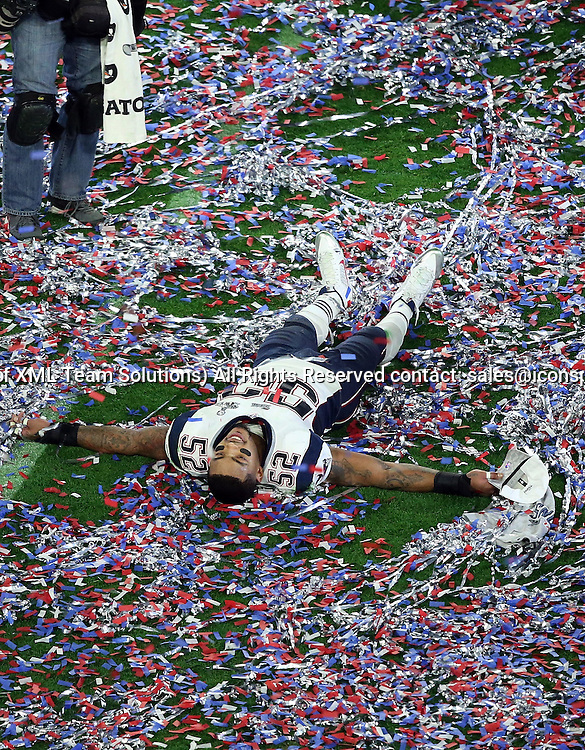 01 February 2015: New England Patriots outside linebacker Jonathan Casillas #52 celebrates in the confetti after winning Super Bowl XLIX at University of Phoenix Stadium in Glendale, Az.  The New England Patriots beat the Seattle Seahawks 28-24.