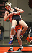 Linn-Mar's Ross Lembeck (front) eyes the mat as he is lifted by Prairie's Trey Blaha during the 152-pound bout of the dual between Linn-Mar and Cedar Rapids Prairie at Prairie High School in Cedar Rapids on December 12, 2013.