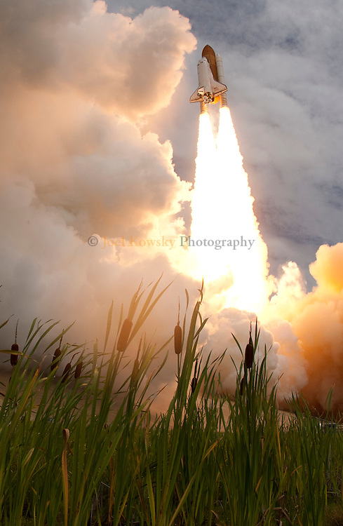 Cape Canaveral, Florida US - Space shuttle Atlantis lifts off from Pad 39A at 11:26AM on Friday, July 8, 2011.  Atlantis is embarking on the 135th and final flight of the Space Shuttle Program and will deliver supplies to the International Space Station.