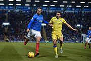 Portsmouth Defender, Christian Burgess (6) beats Bristol Rovers Midfielder, Liam Sercombe (7) to the ball during the EFL Sky Bet League 1 match between Portsmouth and Bristol Rovers at Fratton Park, Portsmouth, England on 19 February 2019.