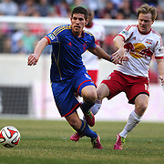 Dillon Powers, (left), Colorado Rapids, is challenged by Dax McCarty, New York Red Bulls, during the New York Red Bulls V Colorado Rapids, Major League Soccer regular season match at Red Bull Arena, Harrison, New Jersey. USA. 15th March 2014. Photo Tim Clayton