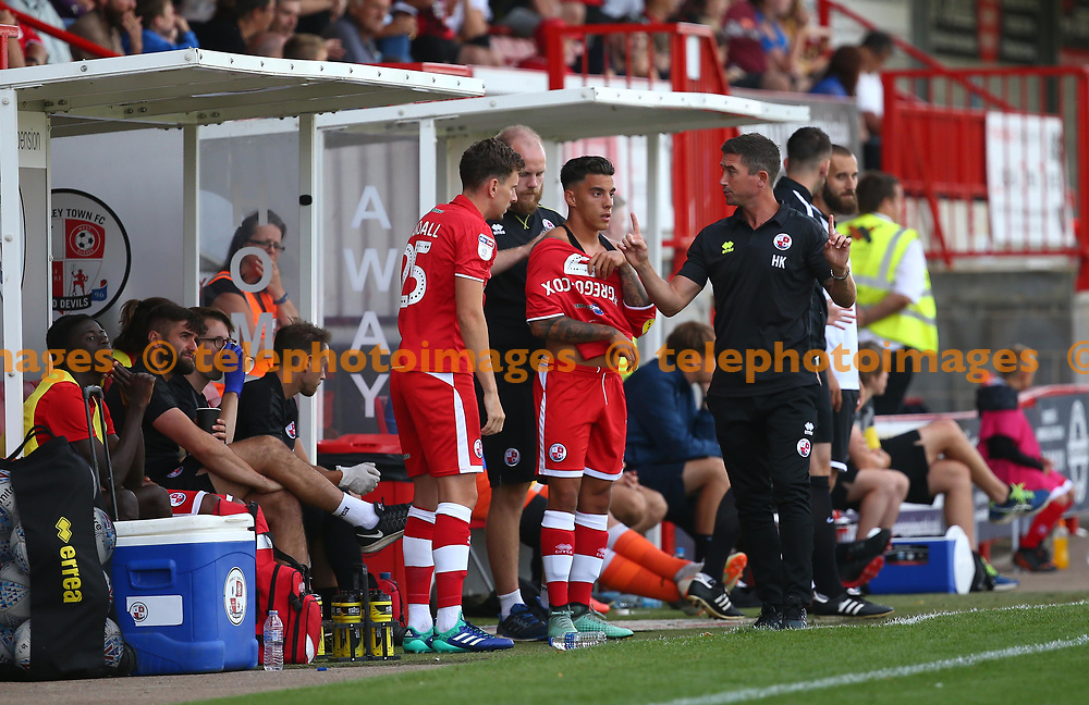 Crawley's Reece Grego-Cox gets direction from Crawley Town's head coach Harry Kewell  the pre season friendly between Crawley Town and KSV Roeselare at The Broadfield Stadium, Crawley , UK. 28 July 2018.