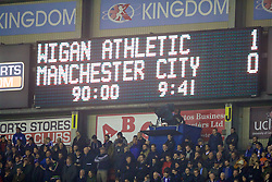 WIGAN, ENGLAND - Monday, February 19, 2018: Wigan Athletic's scoreboard records the 1-0 victory over Manchester City during the FA Cup 5th Round match between Wigan Athletic FC and Manchester City FC at the DW Stadium. (Pic by David Rawcliffe/Propaganda)