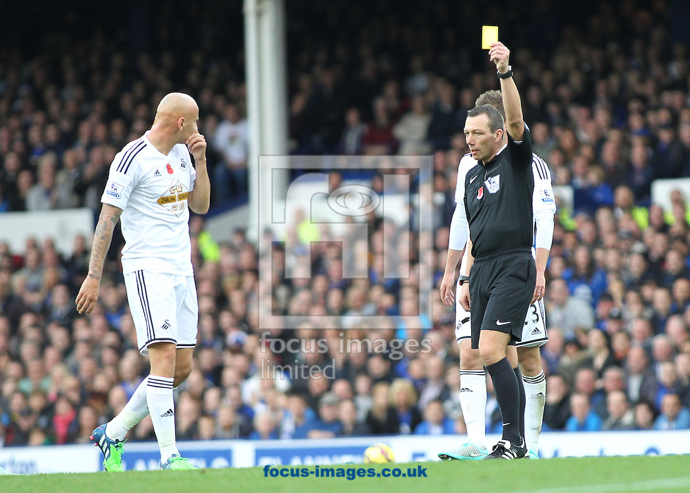 Jonjo Shelvey of Swansea City is booked by referee Kevin Friend during the Barclays Premier League match against Everton, at Goodison Park, Liverpool.<br /> Picture by Michael Sedgwick/Focus Images Ltd +44 7900 363072<br /> 01/11/2014