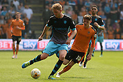 Sheffield Wednesday defender Michael Turner plays the ball away from Wolverhampton Wanderers striker Joe Mason during the Sky Bet Championship match between Wolverhampton Wanderers and Sheffield Wednesday at Molineux, Wolverhampton, England on 7 May 2016. Photo by Alan Franklin.