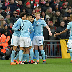 Manchester City players celebrates with Sergio Aguero after he scores a goal to make it 0-1